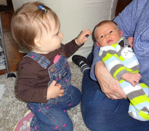 "Nora and her very little friend, Ian, or ""da da"" as she likes to call him (her word for baby)"